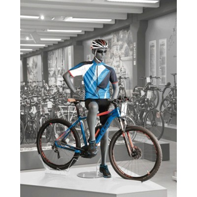 Skyltdocka på cykel